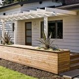 Ideas for enhancing the front porch with a pergola/ trellis.  Mid-century remodel with new ipe deck & planter and urban salvage cedar trellis