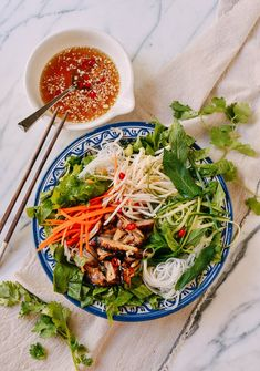 Vietnamese Rice Noodle Salad with Chicken This refreshing, tasty rice noodle salad is perfect for a hot summer day, served with lots of raw crunchy vegetables, seared chicken, and nuoc cham sauce. Vietnamese Noodle Salad, Vietnamese Recipes, Asian Recipes, Healthy Recipes, Ethnic Recipes, Vietnamese Food, Asian Noodle Salads, Asian Salads, Korean Food