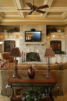 Coffered ceiling, built-ins and beautiful limestone fireplace.