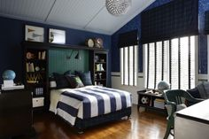 Cool, dark blue teenage boy's bedroom. Get the look with Dunn-Edwards Old Mill DEA185 for your walls.