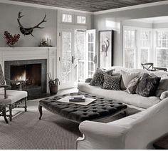 ♅ Dove Gray Home Decor ♅  cozy living room with fireplace and tufted ottoman