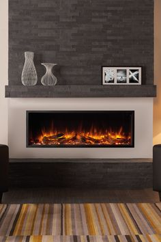 Regency Skope single-sided built in electric fireplace heater features . Regency Skope single-sided built in electric fireplace heater features Chromalight Immersive LED technology and an assortment of fuel effects. Fireplace Feature Wall, Fireplace Tv Wall, Fireplace Built Ins, Bedroom Fireplace, Fireplace Remodel, Modern Fireplace, Living Room With Fireplace, Fireplace Surrounds, Fireplace Design