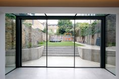 The versatile glass extension on this traditional home uses a glass roof & frameless structural glass sides which connect to our minimally framed sliding doors. Aluminium Sliding Doors, Sliding Door Systems, Sliding Glass Door, Modern Conservatory, Glass Conservatory, Cottage Extension, House Extension Design, Back Painted Glass, Glass Extension