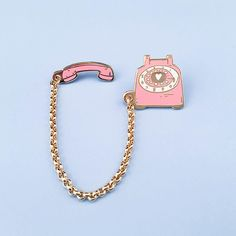 It's your favorite Telephone Pin, now in a delicious Bubblegum Pink color! Details - x & x size- Cloisonné hard enamel set in plated gold with plated gold chain- Rubber clutch clasps- Illustrated & © by Brianna Bulski Stuff And Thangs, Cool Pins, Pin And Patches, Pin Badges, Lapel Pins, Pin Collection, Jewelry Accessories, Creations, Buttons