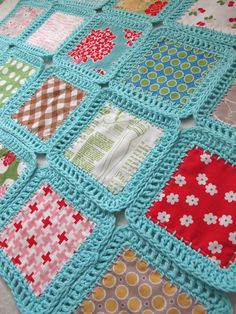 a mix of crochet, fabric and the result is a lacy quilt with a difference...that's my kind of addiction!
