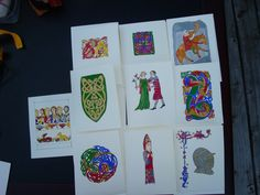 Examples of illuminated note cards.  Blanks can be made, or purchased at a craft store.  Use basic illumination designs to decorate.  Also a great way to start people in the scribal arts.
