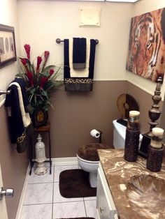 Loving my animal print theme. Downstairs powder room designed by Exquisite Interior Decor.