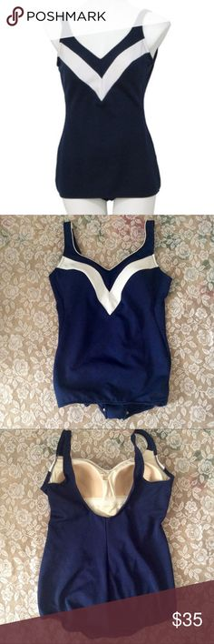 Vintage 60's Robby Len bathing suit, pinup style Awesome 1960's pinup style bathing suit. One piece in navy with a white v shape on the chest. Great condition with a little wear on the inside cup area shown in pic #5. Vintage size 18 which will fit a medium to large. Measures 19 inches armpit to armpit 29 inches in length. Hips 17.5   Measurements are taken with garment laying flat. Vintage Swim