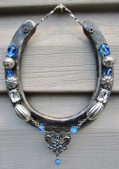 Horseshoe decorated with beads by Grandmajosworkshop on Etsy https://www.etsy.com/listing/490784595/horseshoe-decorated-with-beads