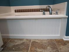 make an old bathtub pretty with beadboard