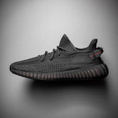 """The adidas Yeezy Boost 350 """"Black"""" features a look reminiscent of the iconic """"Pirate Black"""" colorway of the… Best Sneakers, Black Sneakers, Sneakers Fashion, Adidas Sneakers, Kicks Shoes, Men's Shoes, Yeezy Boost 350 Black, Adidas Boost, Yeezy Shoes"""