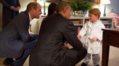 Prince George, adorably outfitted in his monogrammed dressing gown, meets President Obama.