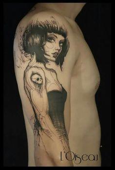 L' Oiseau . Splendide tattouage!