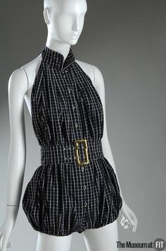 Claire McCardell romper, 1954-56. Collection of The Museum at FIT. Claire McCardell introduced her first playsuit in the 1940s. The designer then refreshed and reinvented the design throughout her career, as she did with several of her most inventive creations. The playsuit's bareness required a lithe young figure and, like much of McCardell's work, was marketed for fashion-savvy young adults.