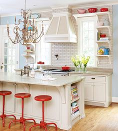 Captivating colors and vintage fittings energize classic kitchen designs.