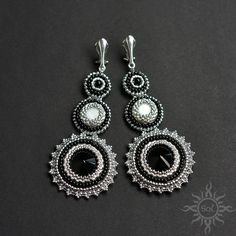 #beading #beadwork #beadweaving #beadembroidery #onyx #motherofpearl #blackandwhite #beadedcabochon #onyxjewelry #elegantjewelry #gemstoneearrings #cliponearrings #onyxearrings #healinggemstone #artisanjewelry #semipreciousjewelry #embroideredearrings #silverjewelry #statementjewelry #statemenearrings #roundearrings #victorianjewelry #longearrings #clipon #blacksilver #clipearrings