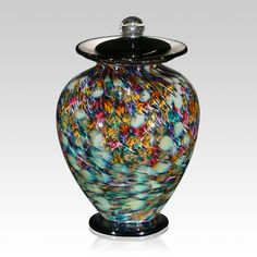 "The Rainbow Glass Cremation Urn is hand blown one at a time. Each piece is unique and made for a special person.  Because each piece is handmade, colors and patterns will vary (The process for adding colors to molten glass is to ""roll"" raw molten glass in pigment glass like you would roll an ice cream cone in sprinkles."