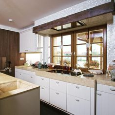 Kitchen in belgian style house. Warm and friendly place. We are proud of this realization in Czech republic. by GORDON DESIGN