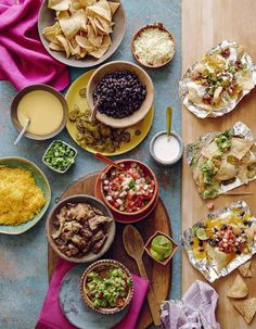 AMAZING idea for a Super Bowl Sunday party idea : How to put together a fun Nachos Bar. Yes! We think it's actually great for any big gathering, when it's just easier to work buffet style and make sure all different tastes are accounted for. | What's Gaby Cooking