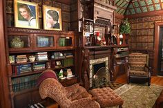 Library with dark wood and leather panels and fireplace