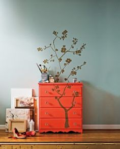 wall sticker---pretty idea.  love how the sticker travels up the dresser onto the wall.