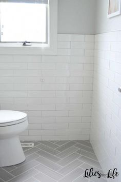 Full bathroom remodel with gray herringbone floor tile, white subway tile walls,. Full bathroom remodel with gray herringbone floor tile, white subway tile walls, black vanity and p Grey Bathroom Floor, Light Grey Bathrooms, White Subway Tile Bathroom, Bathroom Flooring, Grey Floor Tiles Bathroom, Subway Tile Bathrooms, White Tiles Grey Grout, Flooring Tiles, Tile For Small Bathroom