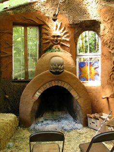 Straw bale and cob house, fireplace - links to many more pictures and a tour ! Fireplace in master bed