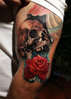 Skull and rose on the leg