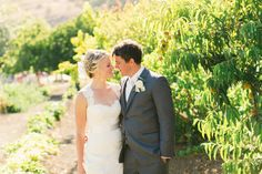 Cayucos creek barn, couple in fruit orchard Makeup and Hair by: Rhonda Johnson