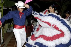 traditional Costa Rican costume performing a folk dance