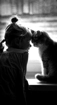 Black & White photo of little girl & cat.