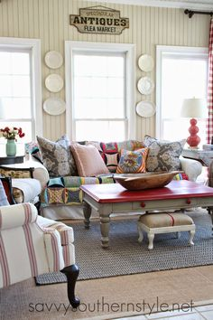 Savvy Southern Style: Winter Sun Room - Love the red top on the coffee table.Makes me wonder what mine would look like in the same color???Mmmmm