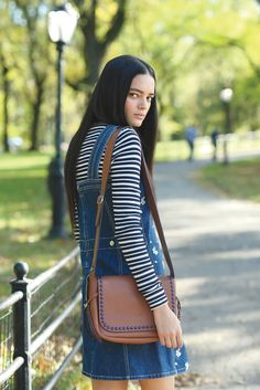 See by Chloé's cotton denim and embroidered dress over cotton and acetate sweater. Coach leather studded bag. [Photo by John Aquino]