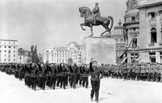 Men of the Fascist Romanian Iron Guard march through the streets of Bucharest as part of a massive party rally in the nation's capital. Kingdom of Romania, Honor Guard, Macabre, World War Ii, Wwii, Germany, Iron, Military, Bucharest, Rally