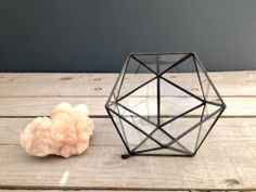 This modified icosahedron form is quite lovely for tabletop display. The opening orients itself in such a way, radiating its curated contents to the viewer. It can hold all sorts of wonders.