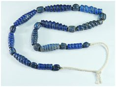 Item Number: tina_4690 Ancient Bactrian Lapis Spiral Twisted Pumpkin Shape Top Gold Fleck Bead Necklace Material: Lapis Weight: 56.33 g. Size: 19