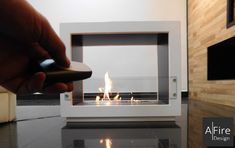 Suggestions and ideas for setting up a decorative fireplace without having to install a vent. Modern & smart fireplaces by AFIRE Bio Ethanol, Minimalist Fireplace, Standing Fireplace, Wall Mounted Fireplace, Bioethanol Fireplace, Conduit, O Gas, Rustic Fireplaces, Decoration