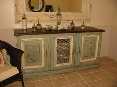 cabinet with repurposed wood and glass, apothecary jars, antique mirror