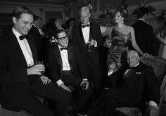 Ken Cosgrove (Aaron Staton), Harry Crane (Rich Sommer), Roger Sterling (John Slattery), Joan Harris (Christina Hendricks) and Bertram Cooper (Robert Morse)