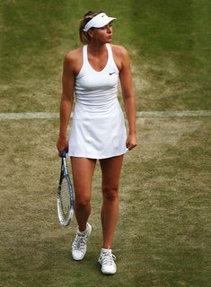 Maria Sharapova Photos: Wimbledon: Day 4. Maria Sharapova of Russia during her Ladies' Singles second round match against Timea Bacsinszky of Switzerland on day four of the Wimbledon Lawn Tennis Championships at the All England Lawn Tennis and Croquet Club at Wimbledon on June 26, 2014 in London, England.