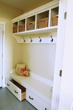 make a box, add wheels, put a pretty face on it - instant mudroom drawers!
