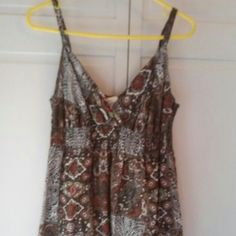 """Brown Floral Strapped Dress Super cute lined dress with an elastic band under the chest section. It's brown with rust, green, black and white colors. It has flowers and other cool designs. This dress has adjustable straps. It measures 29"""" long from the back neckline of dress to the bottom. Looks adorable with flip flops or dressy sandles or heels. Sonoma Dresses"""