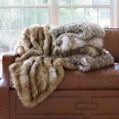 http://ak1.ostkcdn.com/images/products/7278795/Wild-Mannered-Luxury-Long-Hair-Faux-Fur-58x60-Lap-Throw-P14754635g.jpg