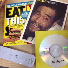 グアム土産にロボ君から頂いたwiiコン型お菓子と春山君から頂いた「食べてはいけない2012年版」と横井さんポストカードと謎のMIXCD。 - @djqko- #webstagram
