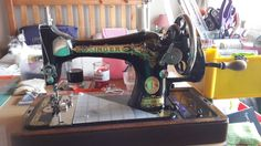 My 1937 Singer 28K (according to her serial number and the Singer website)....She is a hand crank....Her name is Charlotte or TC (Temperamental Charlotte) as here tension goes out of whack when sewing.