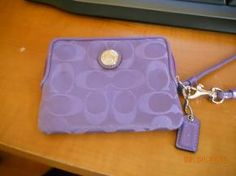 Purple Coach Wristlet..so cute I saved it for a year cause I didnt wanna get it dirty...lol
