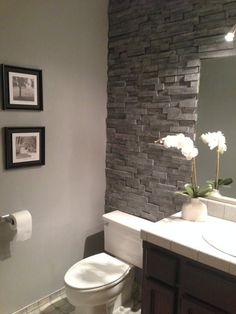 Renovation by: Wendy Location: Nevada City We wanted the look of a stacked stone accent wall in our bathroom. However, we were unable to find a stone veneer that would fit behind our toilet. We decided to use reclaimed pine which we got from used pallets. #BathroomToilets