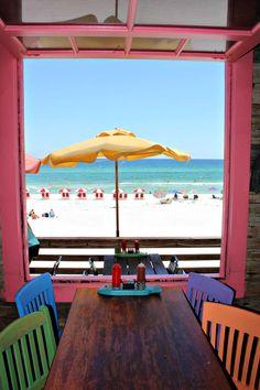 Table with a view at Pompano Joe's, www.beachguide.com/Destin/Restaurants/PompanoJoes