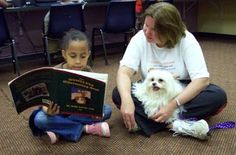 Happy, a Therapy Dog, loves to listen to kids read!