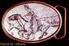 Ivory and Brass belt buckle with Remington drawing of cowboy in a storm. David St. Albans 1984